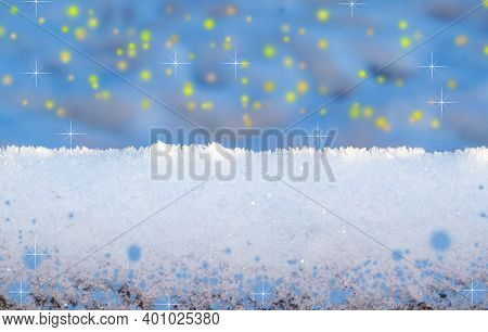 Light Wooden Snow-covered Boards Against The Background Of Blurred Snowdrifts With Bokeh. Copy Of Th