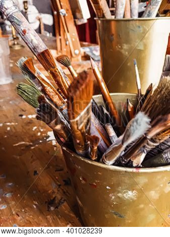 Art Tools In Artist Studio, Paint Brushes And Oil Palette, Creative Hobby And Artistic Workspace Con