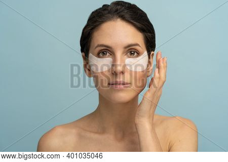 Woman Applying Hydrogel Under-eye Recovery Patches Enriched With Collagen, Vitamin E, Provides Inten