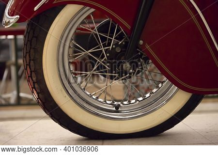 Front Wheel And Fender Of An Old Motorcycle, Close Up Look, Red Chopper With White Wheel Lines