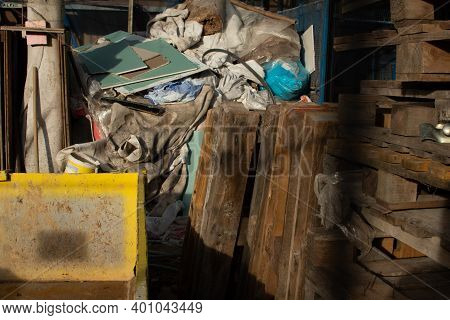 Rubbish From Demolition. Construction Pallets And Rubbish. Construction Site. Building Is Being Reco