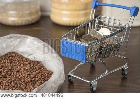 Kazakhstan Tenge Kzt In A Grocery Basket With Bread, Buckwheat Grain And Cereals. Rising Prices For