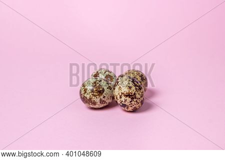 Quail Eggs On A Pink Background. Healthy Food. Several Quail Eggs Lie Next To Each Other
