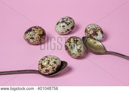 Quail Eggs On A Pink Background. Healthy Food. Quail Eggs Lie On Teaspoons