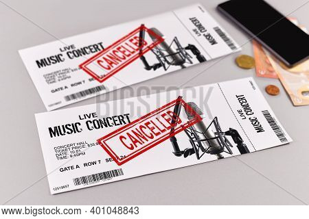 Concept For Cancelled Entertainment Events With Concert Tickets And Red 'cancelled' Stamp On Them