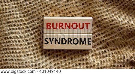 Burnout Syndrome Symbol. Wooden Blocks Form The Words 'burnout Syndrome' On Beautiful Canvas Backgro