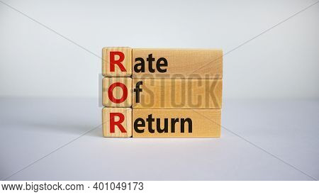 Ror - Rate Of Return Symbol. Concept Word 'ror - Rate Of Return' On Wooden Cubes And Blocks On A Bea