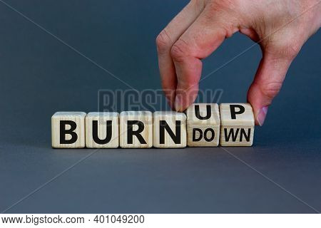 Burn Up, Not Burn Down. Male Hand Flips A Wooden Cube And Changes Words 'burn Down' To 'burn Up'. Be