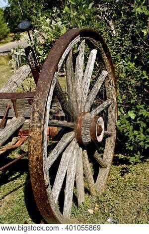 Closeup Of The Wooden Spoked Wheels An Old Horse Pulled Trailer For Hauling Objects