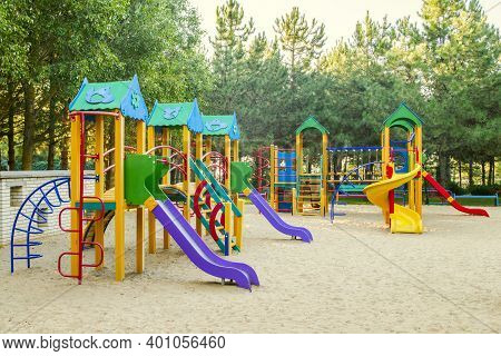 Colorful Children Playground Activities In Public Park. Safe Modern Children's Playground.