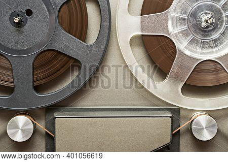Vintage Tape Recorder Is Playing Music, Close Up. Vintage Tape Recorder Roller.