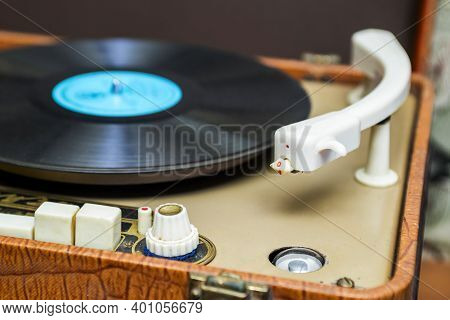 Vinyl Record Player. Turntable Vinyl Record Player Is Playing Music.