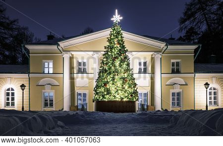 Decorated Christmas Tree In Front Of An Old Manor House In Winter. An Old Classic Russian Manor In W