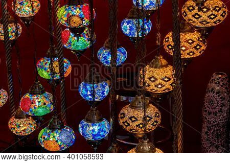 Colourful Turkish Lamps From Glass Mosaic Glowing At Shiny Folk Shop.