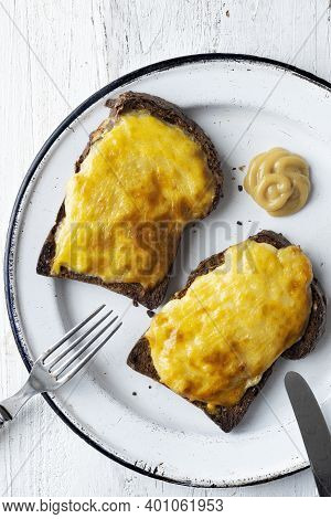 Close Up Of English Pub Grub Welsh Rarebit Cheese Sauce Toast
