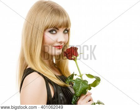 Woman Holding Rose Flower. Attractive Blonde Lady Dark Makeup Studio Shot Isolated On White. Beauty,