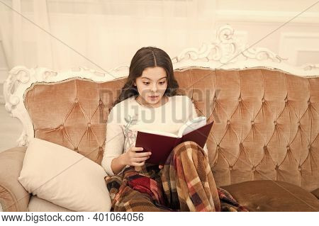 Fantasy Genre. Bookstore Concept. Childhood Literature. Winter Wonderland. Adorable Girl Reading Boo