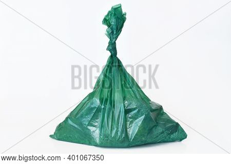 A Close Up Image Of Large Green Dog Poop Bags On A White Background.