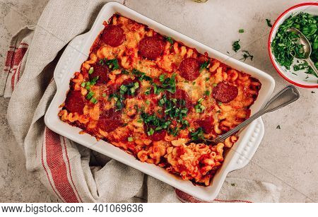 Pasta Baked In A Tomato Pesto Sauce With Cheese, Herbs And Pepperoni. Pizza Pasta