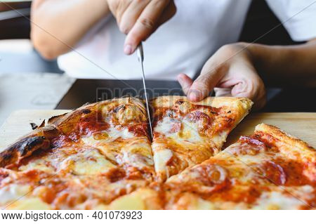 Wood Fire Cheesy Pizza Slice In Hand. Traditional Hawaiian And Salami Pizza Savory Dish Flavour Of O