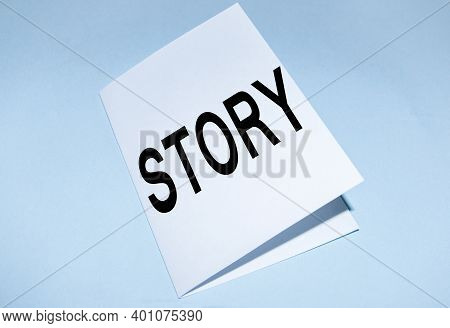 Written By Story, On A Blue Background, A Business Concept Of The Activity Of Writing Stories To Pub