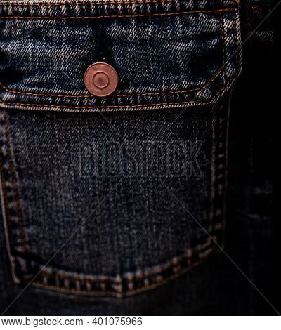 Selective Focus On Denim Jean Jacket Pocket In Clothes Shop. Denim Jacket Pocket And Button Texture.