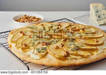 Fruit Homemade Sweet Pear Pizza With Cheese And Honey, Rustic Italian Savory Food With Pastry Dough,