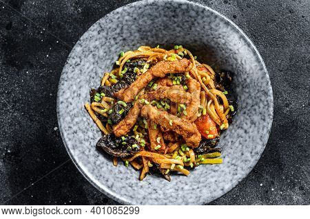 Udon Noodles With Chicken And Peppers. Black Background. Top View