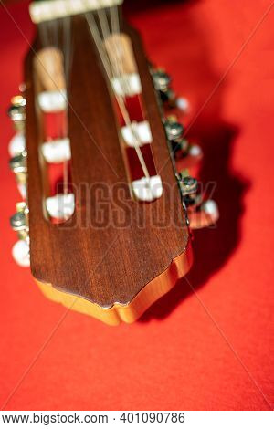 Part Of The Guitar Headstock With The Tuning Pegs