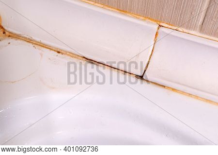 Silicone Sealer Is Mildewed. Mold In The Shower Stall. Dampness And Humidity. Selective Focus