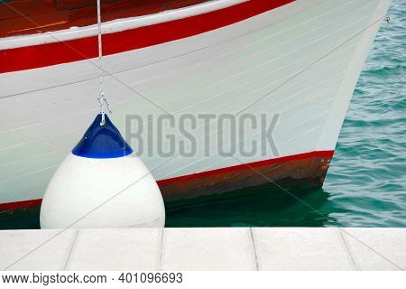 Details of boat side with protection fender sailing boating background with space for text and graphics