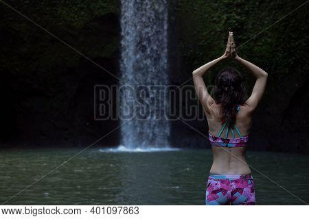 Hands Raising Up In Namaste Mudra. Young Woman Meditating, Practicing Yoga And Pranayama With Namast