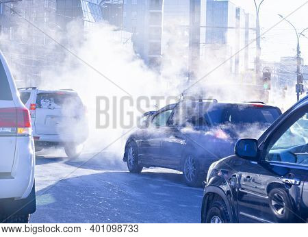 Air Pollution From The Exhaust Of Cars In The City During The Cold Day, Environmental Pollution