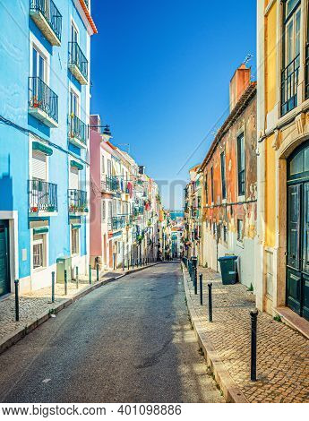 Typical Narrow Street With Colorful Multicolored Traditional Buildings And Houses In Lisbon Lisboa H