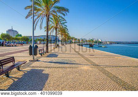 Ribeirinha De Portimao Town, Cobblestone Embankment Promenade Of Arade River In City Centre With Pal