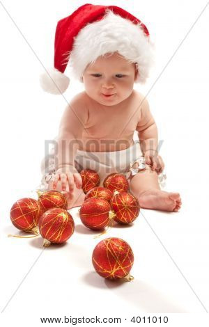Baby In Santa Hat Playing