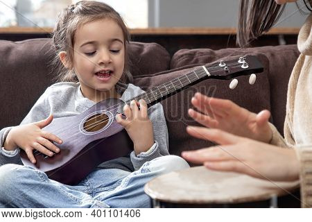 Lessons On A Musical Instrument. Children's Development And Family Values. The Concept Of Children's