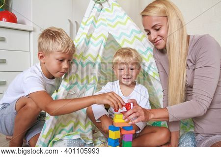 Mom And Son Build A Tower Together From Constructor
