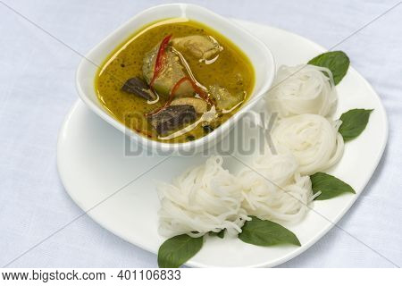 Rice Vermicelli With Green Curry Chicken In White Plate Is A Favorite Thai Food.