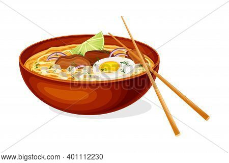 Thick Broth With Noodles, Meat And Boiled Egg As Asian Savoury Soup Served In Bowl With Chopsticks V