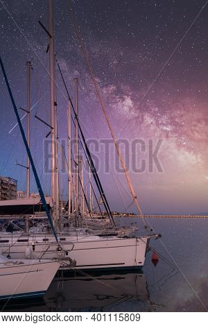 Scenic View Of The Yachts Moored In The Port Of Volos Under Starry Night Sky, Greece.