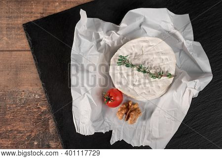 Delicious Brie Cheese On Black Background. Brie Type Of Cheese. Camembert. Fresh Brie Cheese And A S