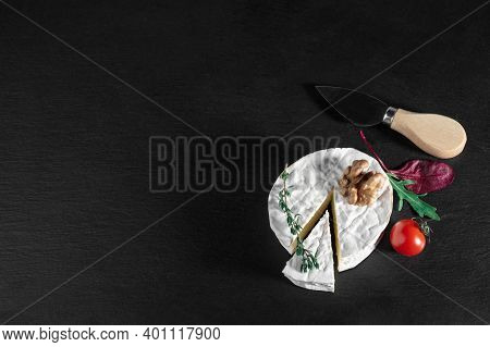 Delicious Brie Cheese With Tomato And Walnut On Black Background. Brie Type Of Cheese. Camembert. Fr