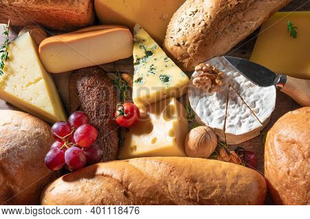 Cheese And Bread Background. Many Types Of Bread And Cheese. Cheese Platter, Tasting And Pairing. An