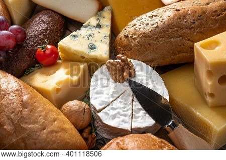 Cheese And Bread Background. Many Types Of Bread And Cheese. Cheese Platter, Tasting Assortment Of V