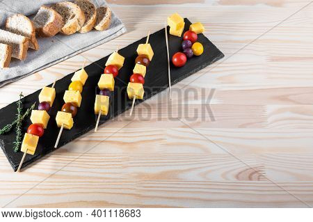 Canapes From Olives, Cheese And Cherry Tomato On Skewers. Finger Food. Slices Of Cheese And Tomatoes