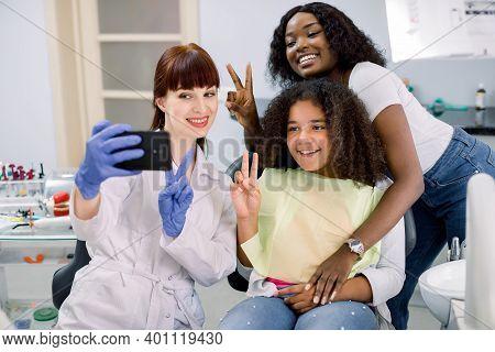 Dentist Office, Pediatric Dentistry. Female Pediatric Dental Specialist Making Selfie Photo On Smart