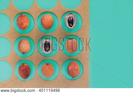 Tropical Fruits - Lychee Or Litchi On Green Background With Copy Space. Trendy Geometric Composition