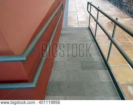 Access Ramp To The Building For The Disabled With Handrails. External Disabled Accessible Ramp For W