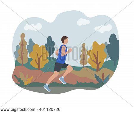 A Man Runs In An Autumn Park. Sports Training On The Street. Runner In Motion. Marathon And Long Run